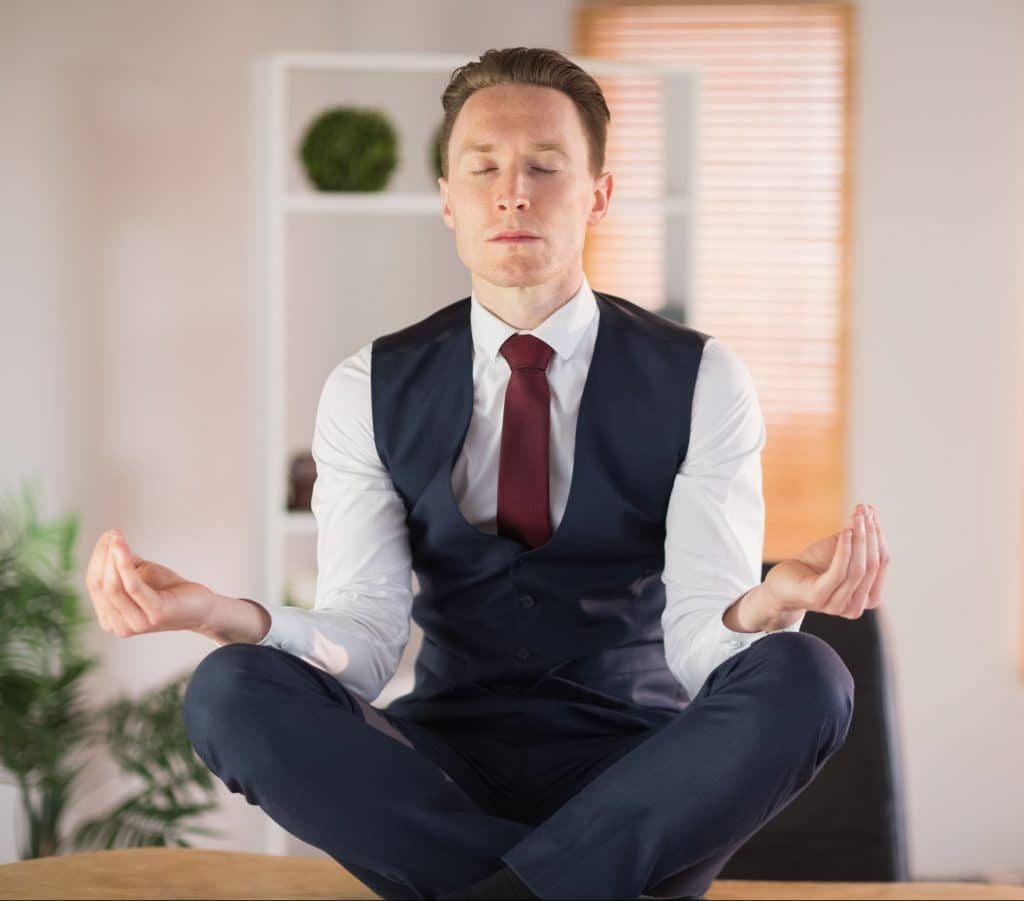 business man meditating